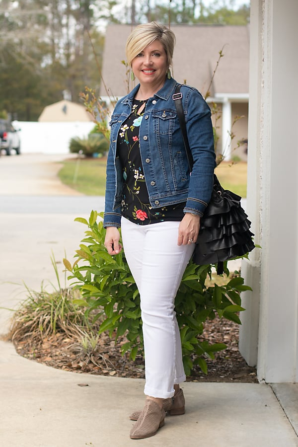 denim jacket with black floral top and white jeans
