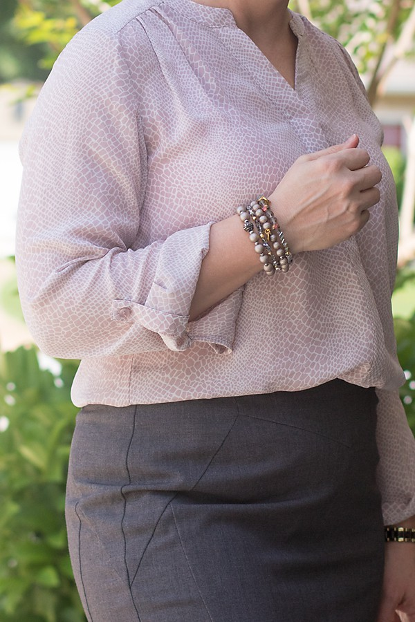 bracelets and python print blouse