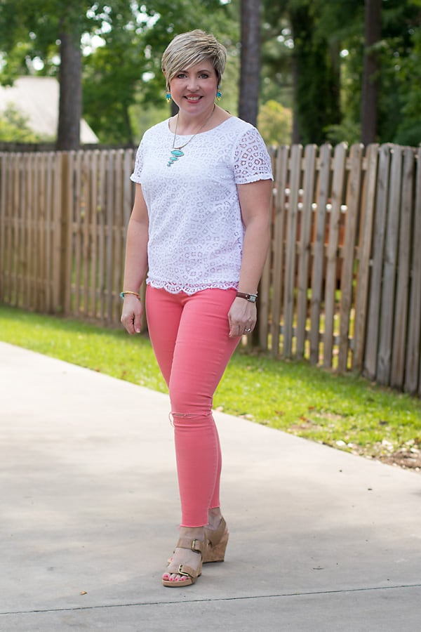 coral jeans with white lace top