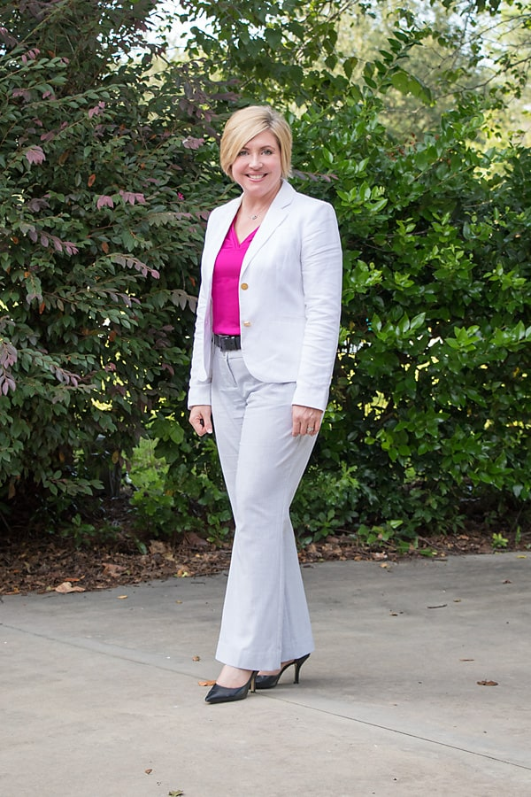 white blazer and grey pants