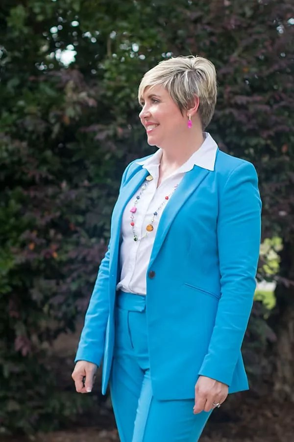 bright suit with colorful necklace