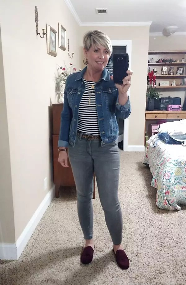 denim jacket with striped top and grey jeans