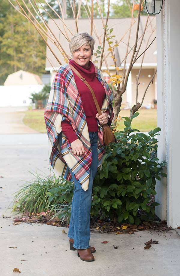 sweater and boot cut jeans with plaid blanket scarf Christmas winter outfit