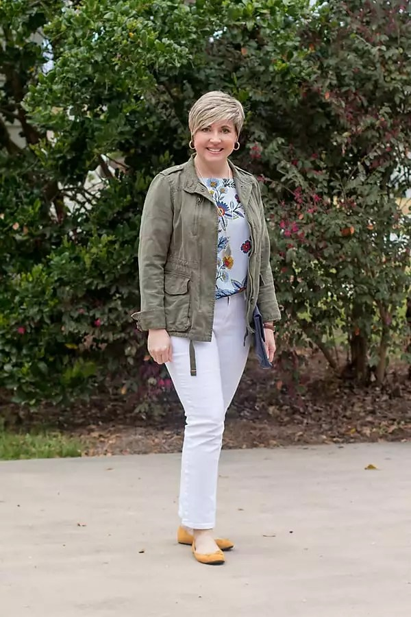 white jeans outfit with utility jacket