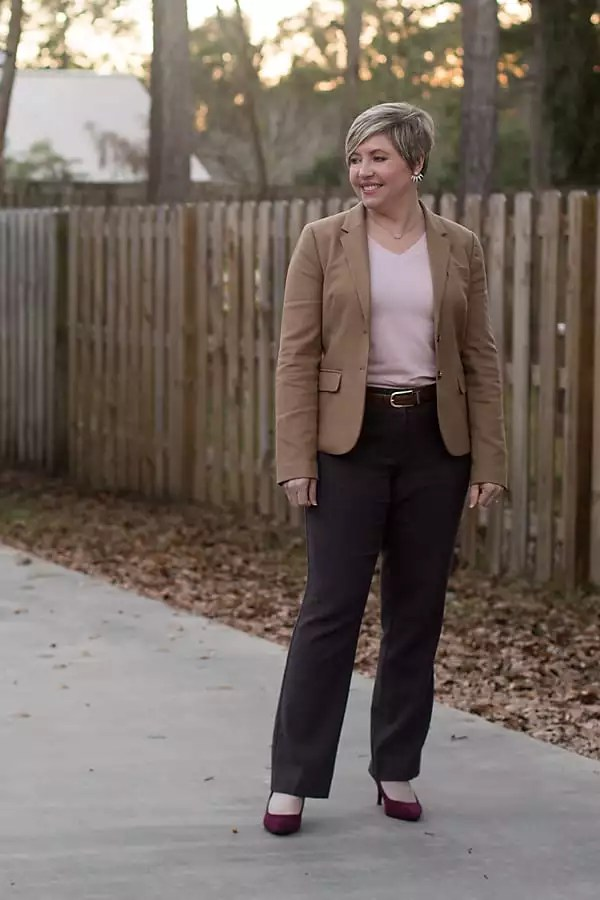 office outfit for women with camel blazer and pink sweater