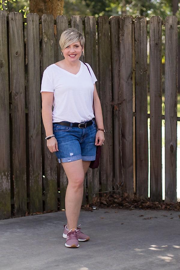 white v-neck t-shirt with denim shorts