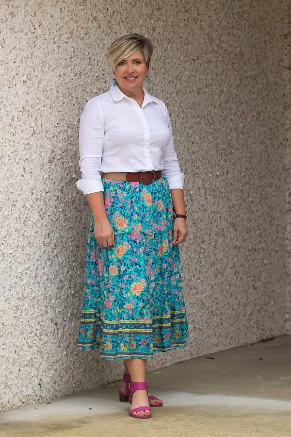 Wear a midi skirt with a white button up and wide belt.