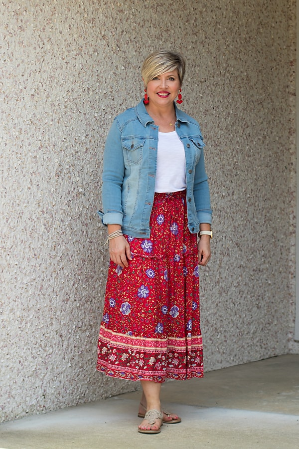 Wear a midi skirt with a light wash denim jacket in the summer.