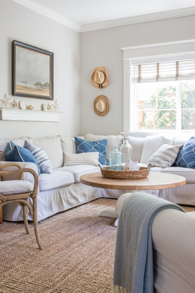 The family room is right off the kitchen at the back of our home i love coastal decor and summer is the perfect time to display a few beachy treasures