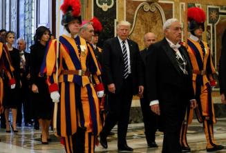 U.S. President Donald Trump and first lady Melania Trump pass a Swiss Guard as they arrive at the Vatican, May 24, 2017. REUTERS/Jonathan Ernst