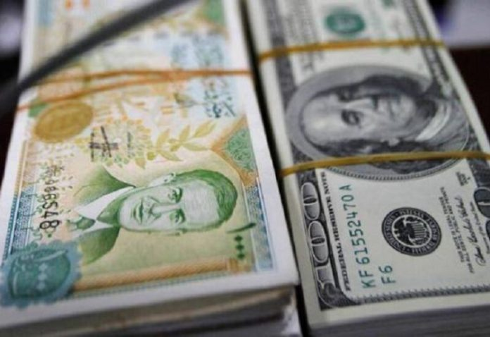 The Syrian pound improved against the dollar