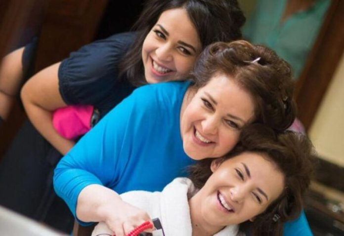 Dalal Abdel Aziz with her daughters Donia and Emmy