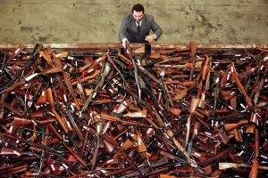 Mick Roelandts, firearms reform project manager for the New South Wales Police, looks at a pile of about 4,500 prohibited firearms in Sydney that have been handed in over the past month under the Australian government's buy-back scheme July 28. A total of 470,000 guns have been collected nationally, with owners receiving A$243 million (US$180 million) in compensation. The scheme was set up due to tighter gun laws brought in after the April 1996 Port Arthur massacre in which 35 people died when a lone gunman went on a shooting rampage.