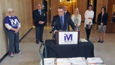 TOM STROMME/Tribune Shane Goettle, a member of the committee sponsoring Marsy's Law, speaks at a press conference in the state capitol on Tuesday morning prior to petitions, shown in front of podium, being delivered to the Secretary of State's office. In back from left are Marsha Lembke, Burleigh County Sheriff Pat Heinert, Kelly Leben of the Burleigh County Sheriff's Department, Lacee Anderson, Kathleen Wrigley and Nicole Peske. For a video of the press conference go to www.bismarcktribune.com.