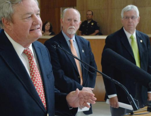 North Dakota Governor Jack Dalrymple, left, announces on 7-13-2016 his decision to call for a special legislative session for Aug. 2, 2016 from Memorial Hall in the state Capitol in Bismarck, North Dakota. In the background is House Majority Leader Al Carlson, R-Fargo, left, and Senate Majority Leader Rich Wardner, R-Dickinson.