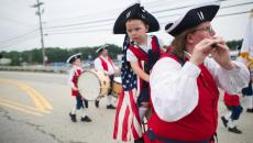 Therese Cuccia and her son Francis, 2, of Bethlehem, Connecticut participate in the Independence Day parade in Merrimack, New Hampshire July 4, 2015. REUTERS/Gretchen Ertl