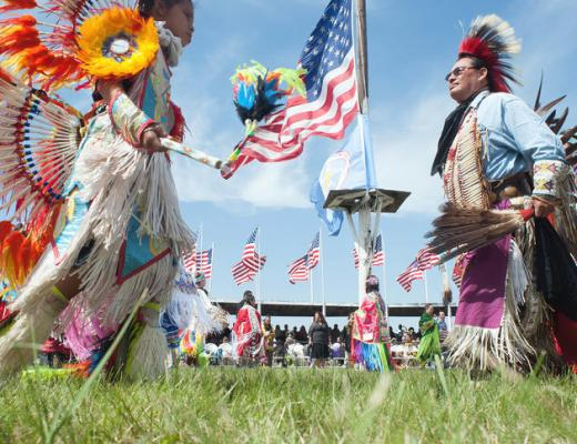 Dancers make their way around the arena at the Cannon Ball Flag Celebration during President Barack Obama's visit to Cannon Ball, N.D. on Friday, June 13, 2014. (Kevin Cederstrom/Forum News Service)