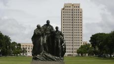 """The Pioneer Family"" stands in front of the North Dakota State Capitol on July 14, 2016, in Bismarck. Michael Vosburg / Forum Photo Editor"