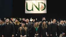 The UND Class of 2016 looks around as graduates process in for commencement Saturday at the Alerus Center in Grand Forks. photo by Eric Hylden/Grand Forks Herald