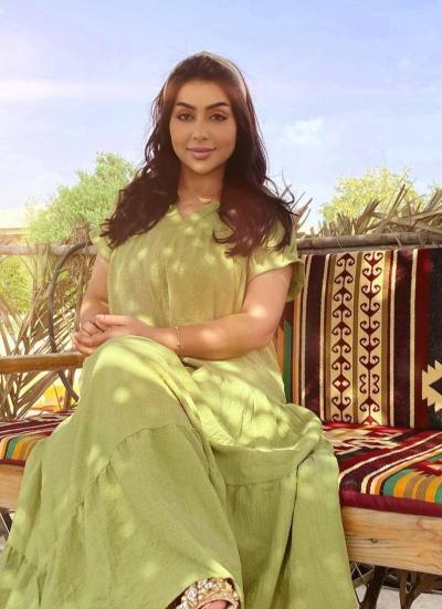 7-غادة الزدجالي بفستان أخضر ناعم- صورة من حسابها على انستجرام
