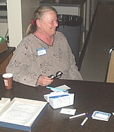 Anita Donohoe at the welcome table.