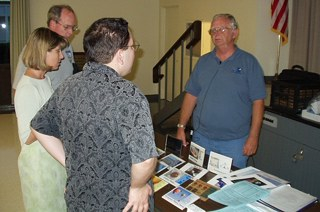 Don Baker displays papers and ink cartridges at the August meeting. (Photo: Brian Carlin)