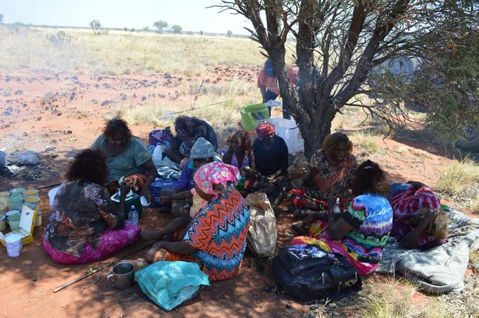 Women story telling and singing in Kintore, Northern Territory.