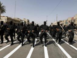 Mehdi Army fighters loyal to Shi'ite cleric Moqtada al-Sadr take part during a parade in Baghdad's Sadr city