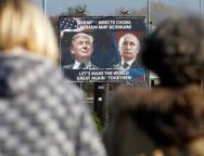FILE PHOTO: A billboard showing a pictures of US president-elect Donald Trump and Russian President Vladimir Putin is seen through pedestrians in Danilovgrad