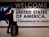 An international passenger arrives at Washington Dulles International Airport after the U.S. Supreme Court granted parts of the Trump administration's emergency request to put its travel ban into effect later in the week pending further judicial review