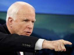 U.S. Senator McCain attends a session of World Economic Forum in Davos