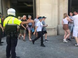 People are evacuated after a van crashed into pedestrians near the Las Ramblas avenue in central Barcelona