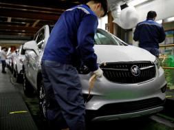 FILE PHOTO: An employee works at an assembly line of GM Korea's Bupyeong plant in Incheon