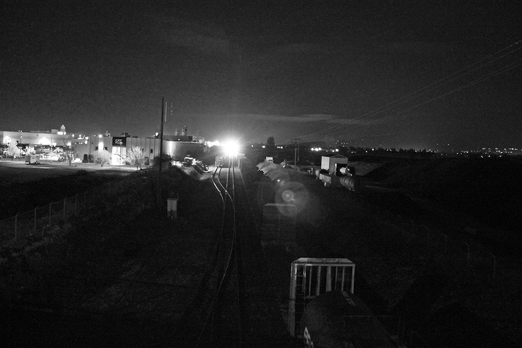locomotive approaching from the distance at night