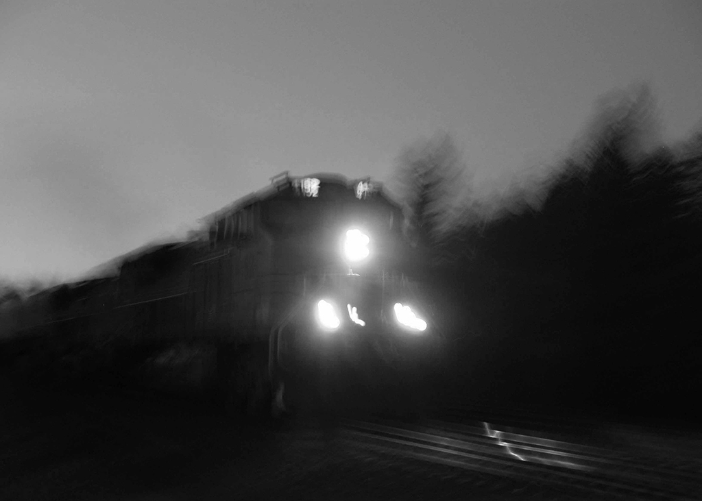 speeding locomotive at night