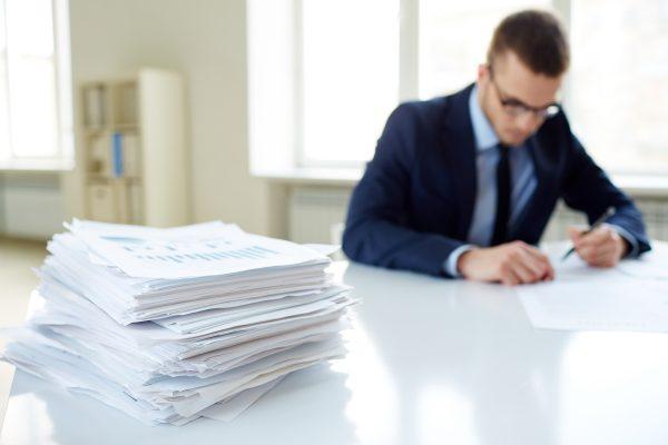 blurry guy filling in paperwork
