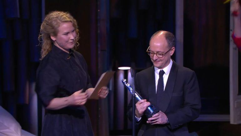 Ed Guiney of Element Pictures receives the award for Best Comedy at the 32nd European Film Awards