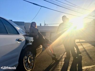 Lilith Emlee Vassilos against car