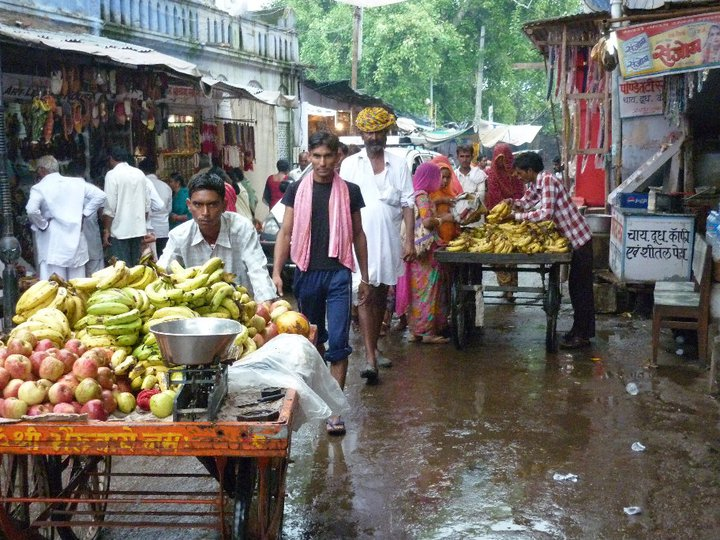 street life in India - life goes on - despite the rain