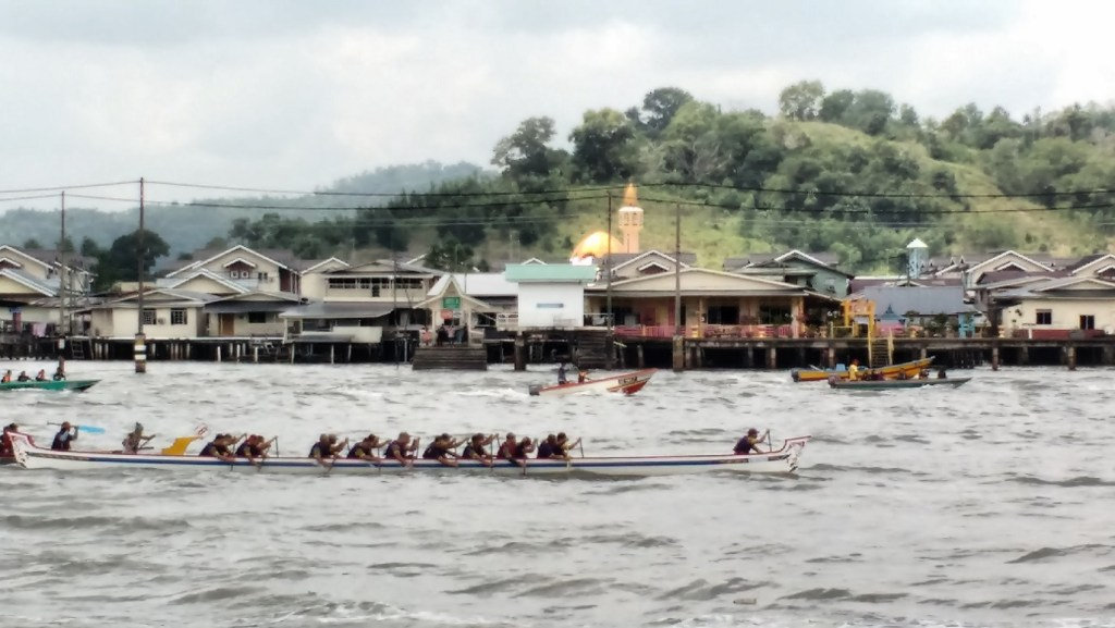 Boat race on the river with Kampung Ayer in the background