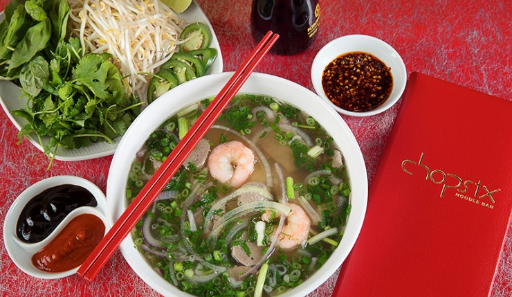 A stunning bowl of Pho noodles with fresh shrimp
