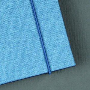 Kleines Notizbuch un zwei Blautönen