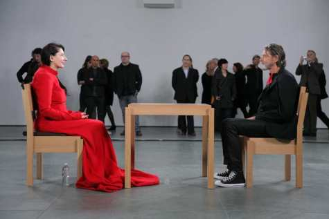 "Marina Abramovic and Ulay sit across from each other in ""The Artist is Present,"""