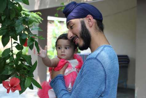 Senior Jag Lally holds a baby girl from Unique Home, the girls' orphanage in Jalandhar.