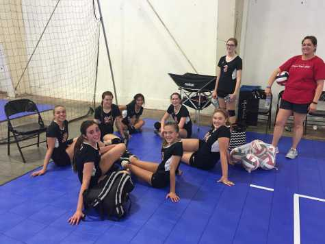 The JV volleyball girls take a break after a loss to the Granite Bay Grizzlies in the third set of the championship round for the bronze bracket of the Carmichael Invitational Tournament Sept. 19. In between games, the girls played cards, did homework and enjoyed food from the potluck the parents put on.