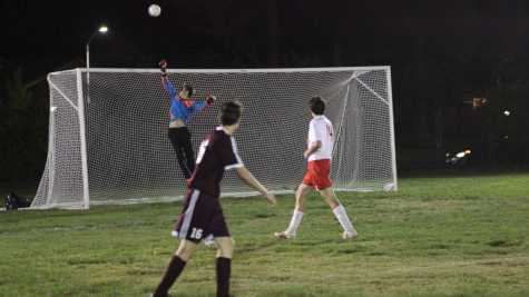 Senior Brad Petchauer, goalie and captain, jumps to block a potential goal.