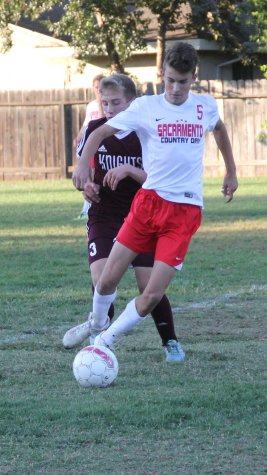 Sophomore Theo Kaufman dribbles around a Buckingham defender. In the second half, Kaumfan scored on a penalty kick.