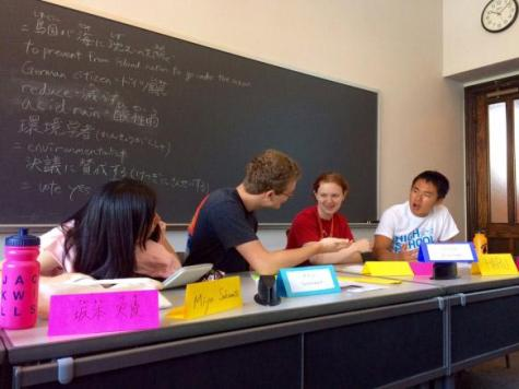 Adams and three other students debate environmental issues at Seminar class.
