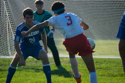 Sophomore Jayce McCain sends the ball into the back of the net.