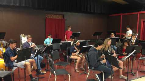 The high-school band practices for the upcoming concert on Wednesday, April 27.